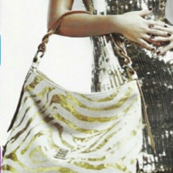 Dooney & Bourke Handbags - Dooney & Bourke zebra gold white large leather bag